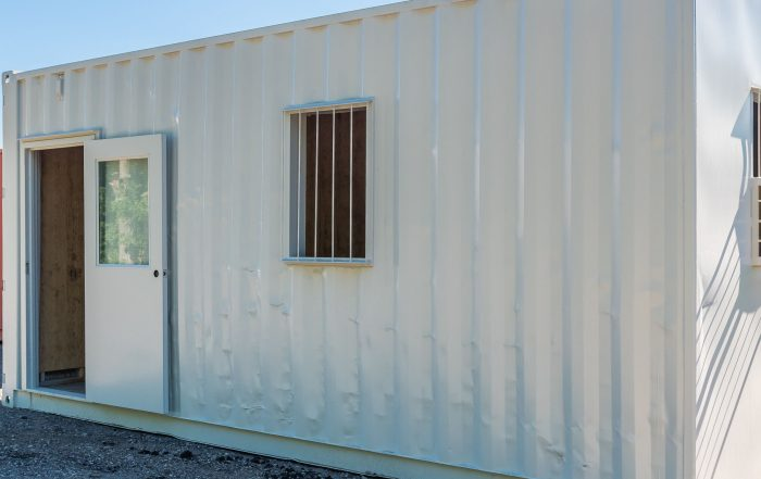 Sustainable and Affordable Office Space with Stacked Shipping Containers